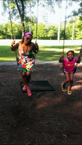 L Griffin swinging with daughter