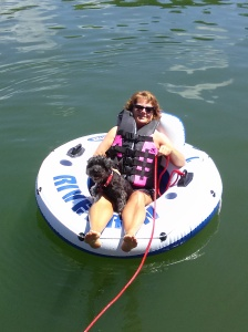 Cherilyn Donovan Medical Admin with dog Darby on Lake Nottely