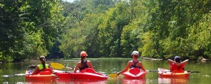 Tonya West girls kayaking from back