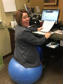 Casey Morton is using a stability ball to improve her core strength and posture.